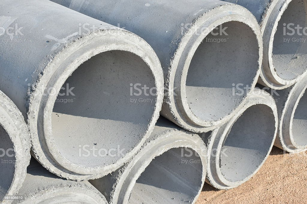 Cement pipes stacking at yard stock photo