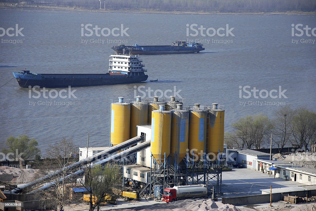 cement plant on river side royalty-free stock photo