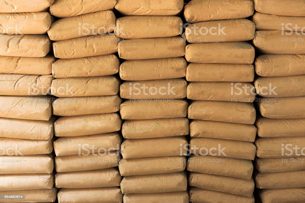 Cement powder bags stacked background - foto de acervo