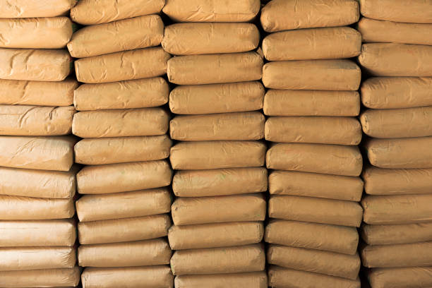 Cement powder bags stacked background stock photo