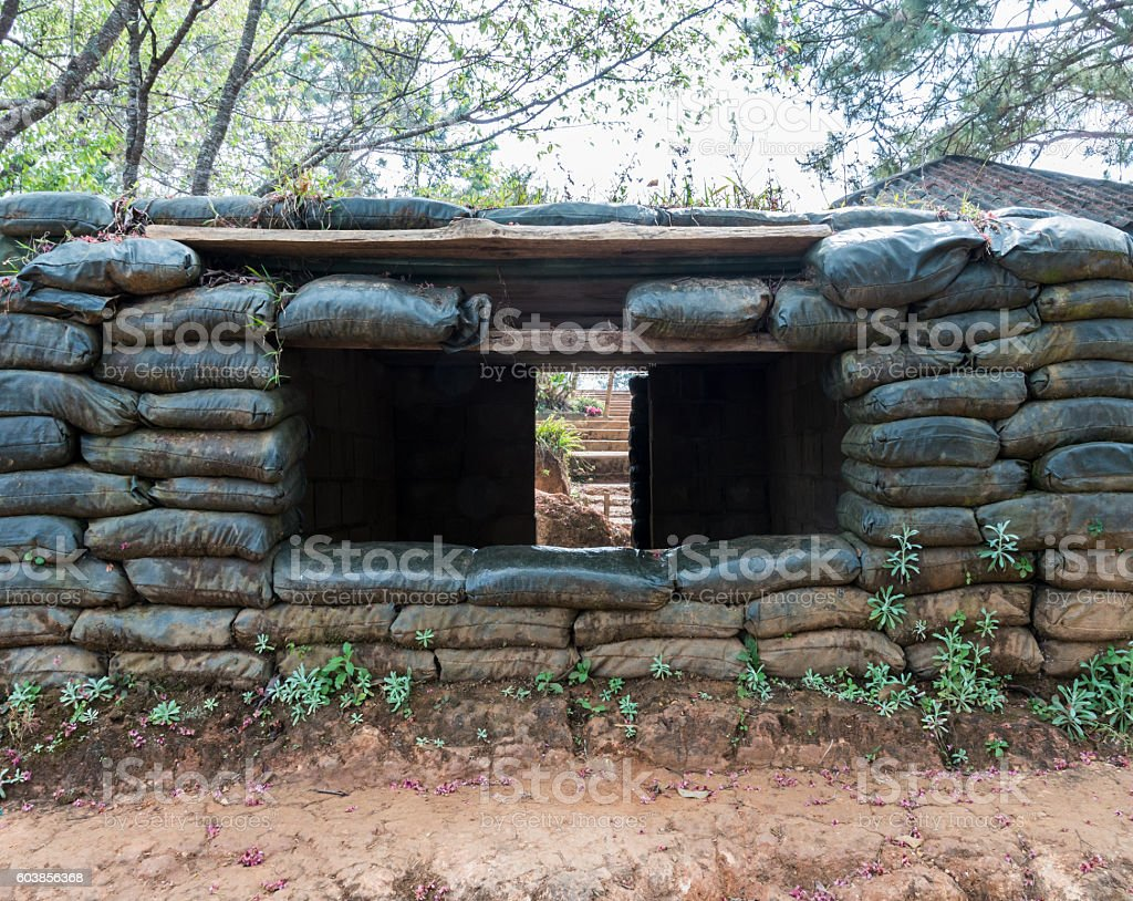 Cement shelter with sandbag. stock photo