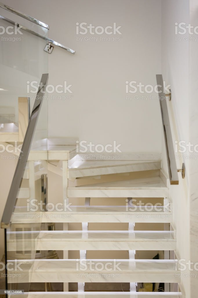 Cement Stair Railing Stainless Steel Up To The Second Floor With Glass  Block Wall. Royalty