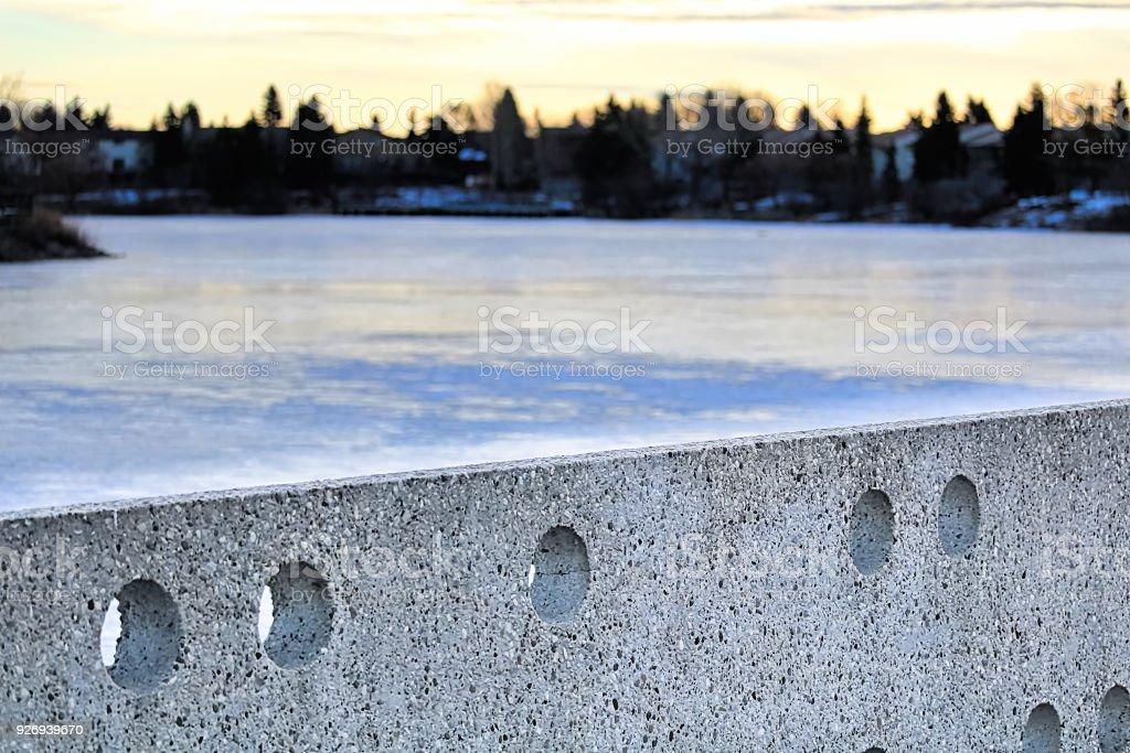 Cement Wall At Beaumaris Lake Edmonton During Winter Stock