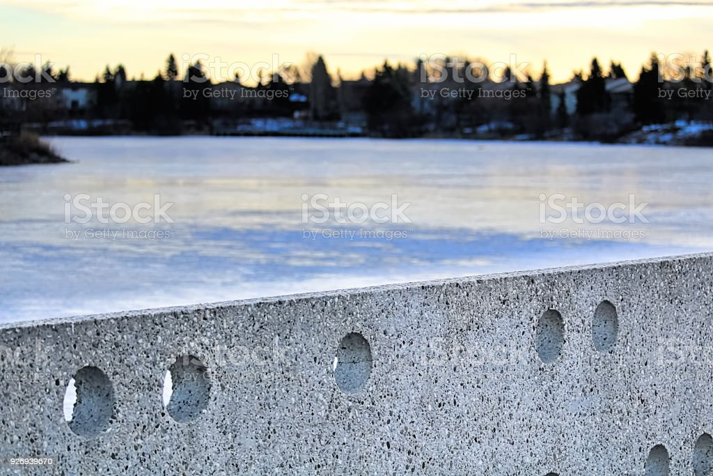 Cement wall at Beaumaris Lake Edmonton during winter stock photo