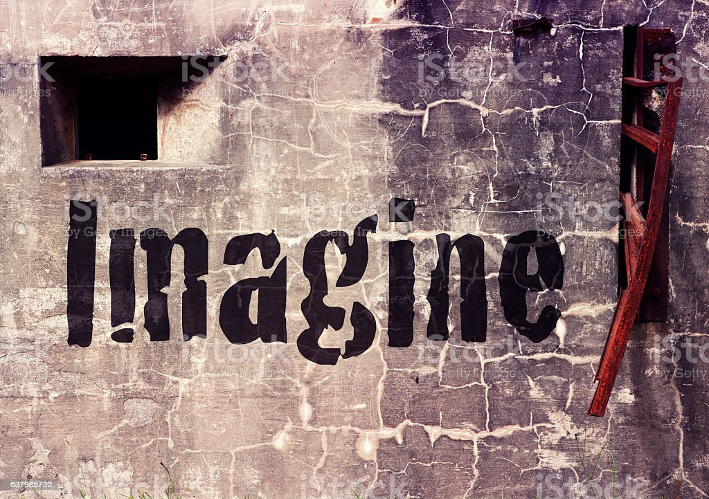 cement wall with the word Imagine stock photo