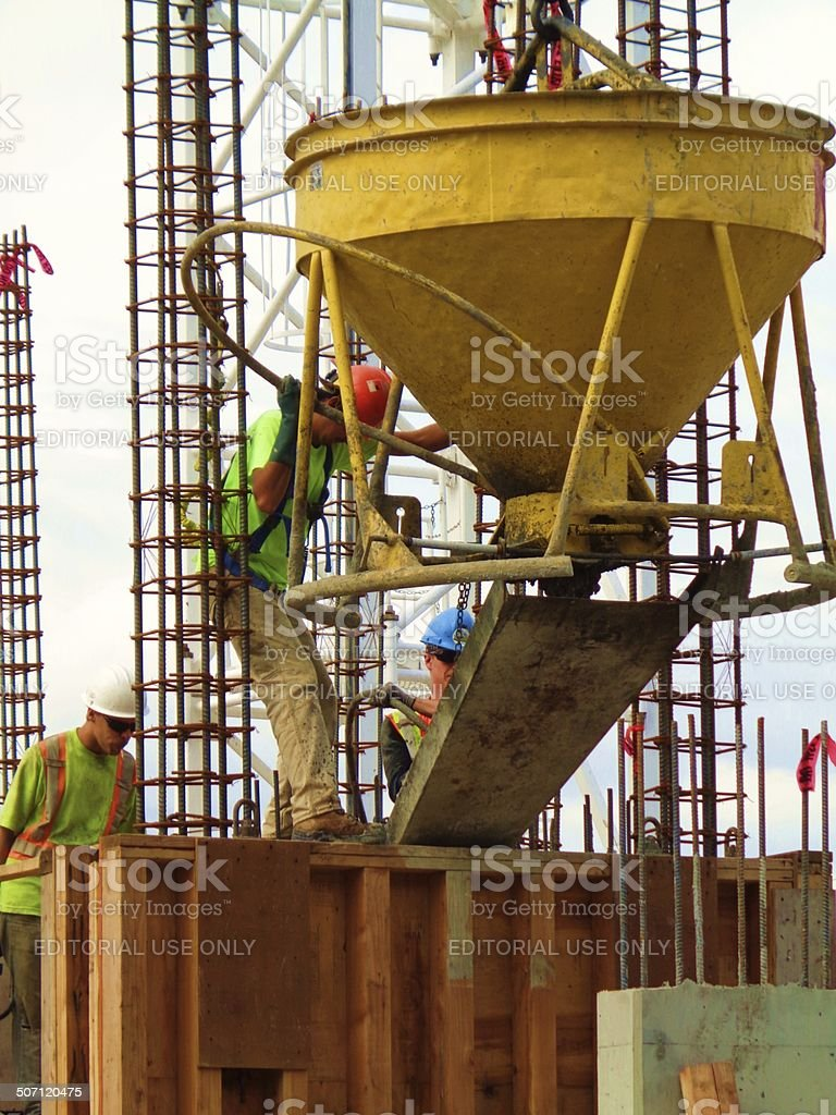 Cement workers on construction site stock photo