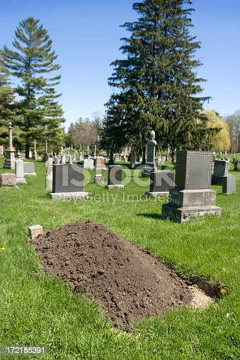 Dirt piled at cemetary plot.