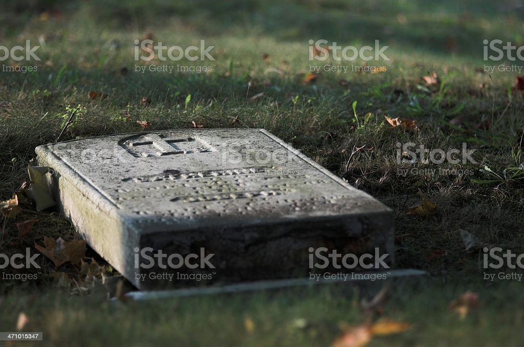 cemetary toppled tombstone royalty-free stock photo