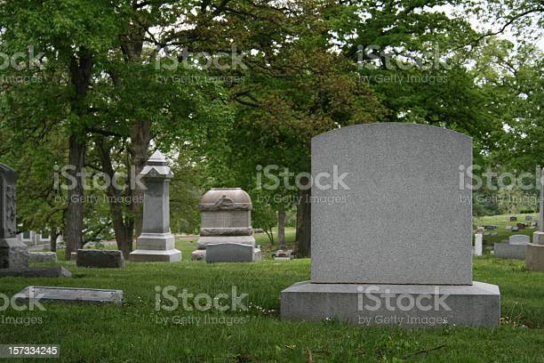 A Cemetery And Tombstone In The Daylight Stock Photo - Download Image Now