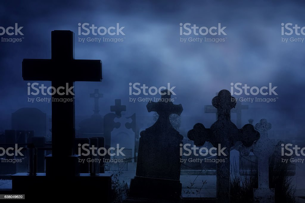 cemetery at night stock photo