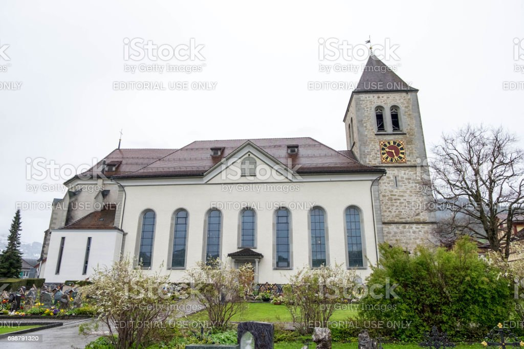 Cemetery beside St. Mauritius Church at downtown of Appenzell town. stock photo