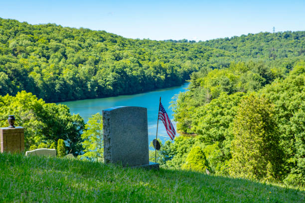 Cemetery By The Lake A hilltop cemetery by a lake. sdominick stock pictures, royalty-free photos & images