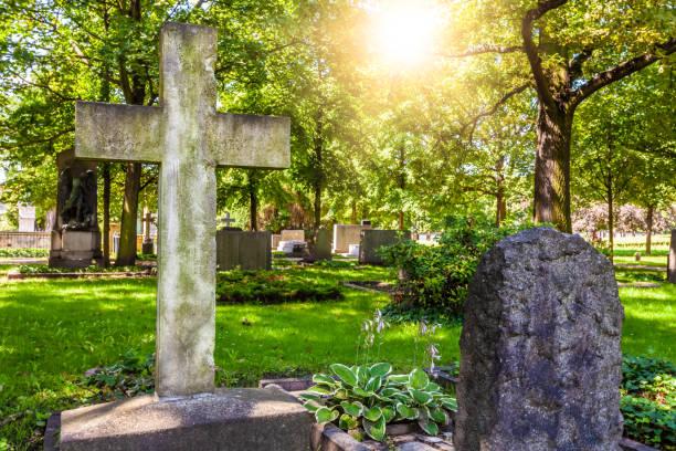 Cemetery cross with sun stock photo