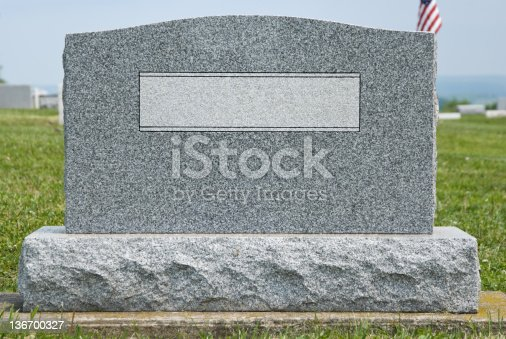 Cemetery headstone close up with no name engraved, new gray granite blank marker in modern contemporary style, ready to add your own text.