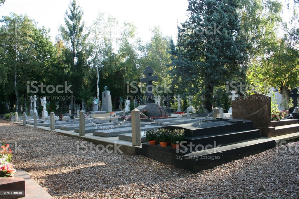 Cemetery in Central Europe in the shade of thick trees stock photo