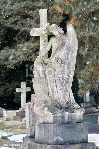 Stone angel headstone in country church yard