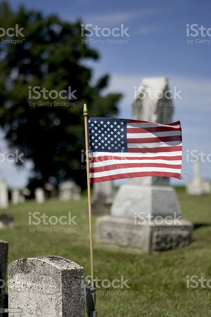 Cemetery in the country with flag royalty-free stock photo