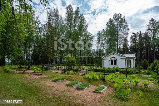 Lode, Latvia - June 7, 2020: Cemetery near Lode, (Apsu) Lutheran Church