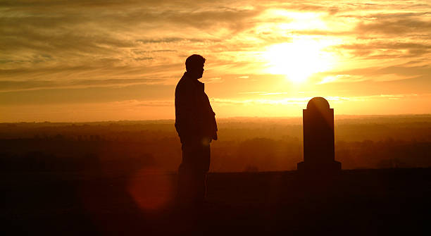 cemetery silhouette - tragedy mask stock photos and pictures