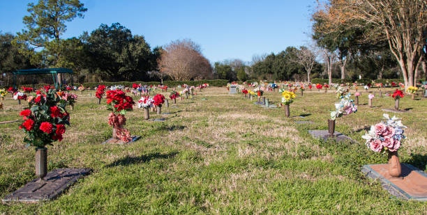 Cemetery with decorative floral memorial displays. stock photo