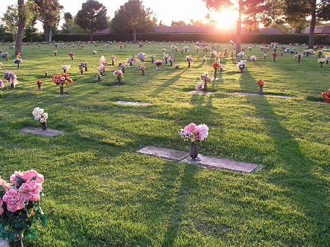 A cemetery with flowers at sunset