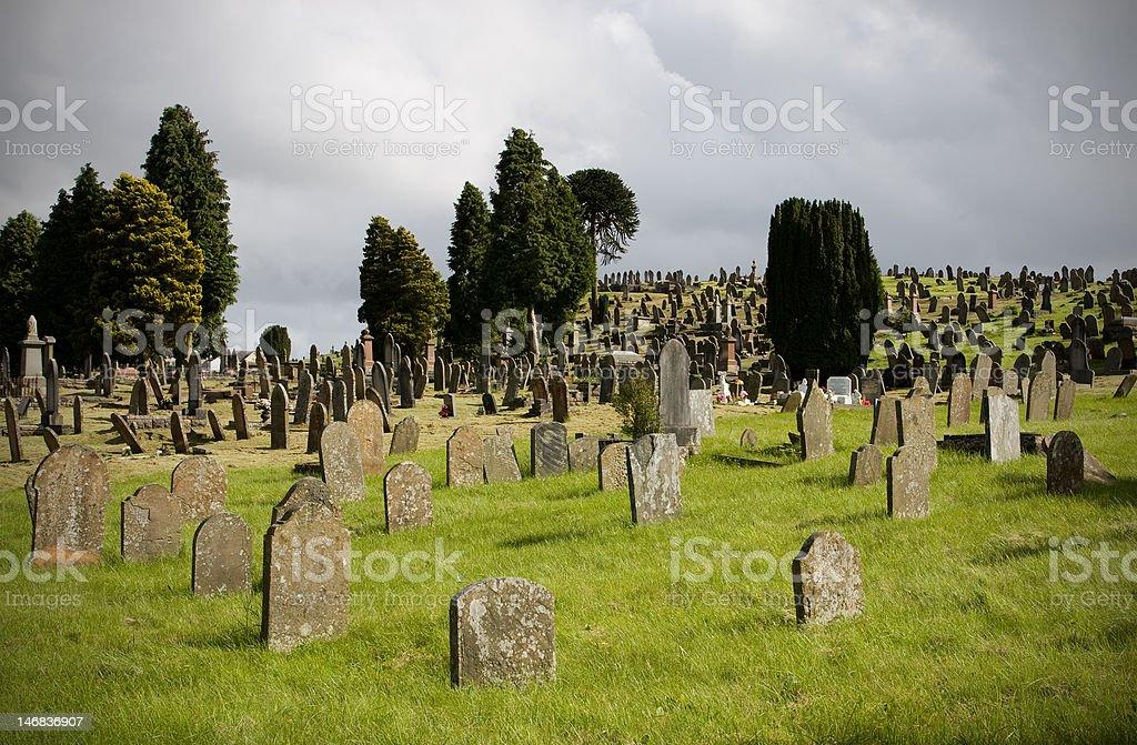 Cemetery with obsolete bent gravestones royalty-free stock photo