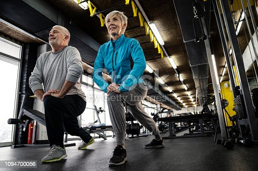 Cenior couple doing exercises in gym