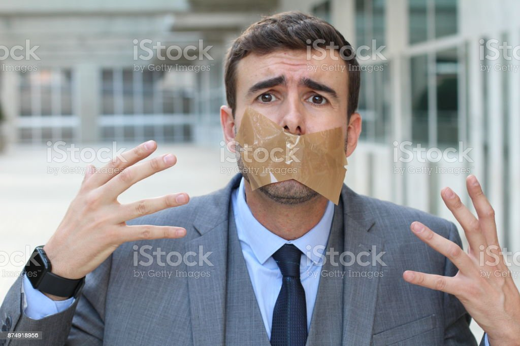 Censored businessman unable to express his opinion stock photo