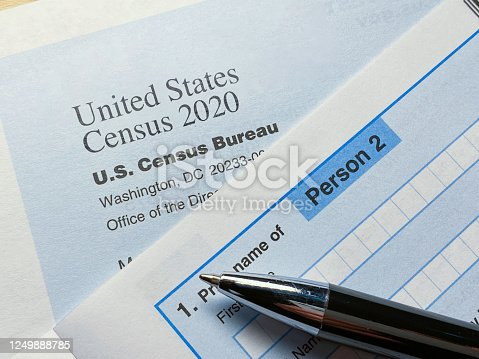 Census 2020: survey form on desk in office with pen ++ logo is NOT official USA Census 2020 logo ++ created by photographer++