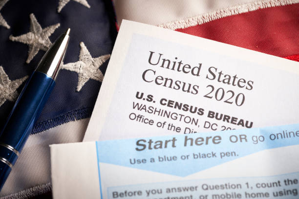 Census 2020: survey questionnaire form on desk with pen and usa flag stock photo