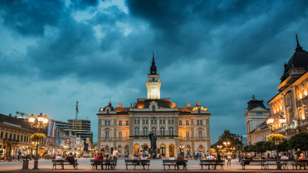 Center of Novi Sad at evening Novi Sad, Serbia - September 03, 2018: Evening at Novi Sad, with people passing by and sitting serbia stock pictures, royalty-free photos & images