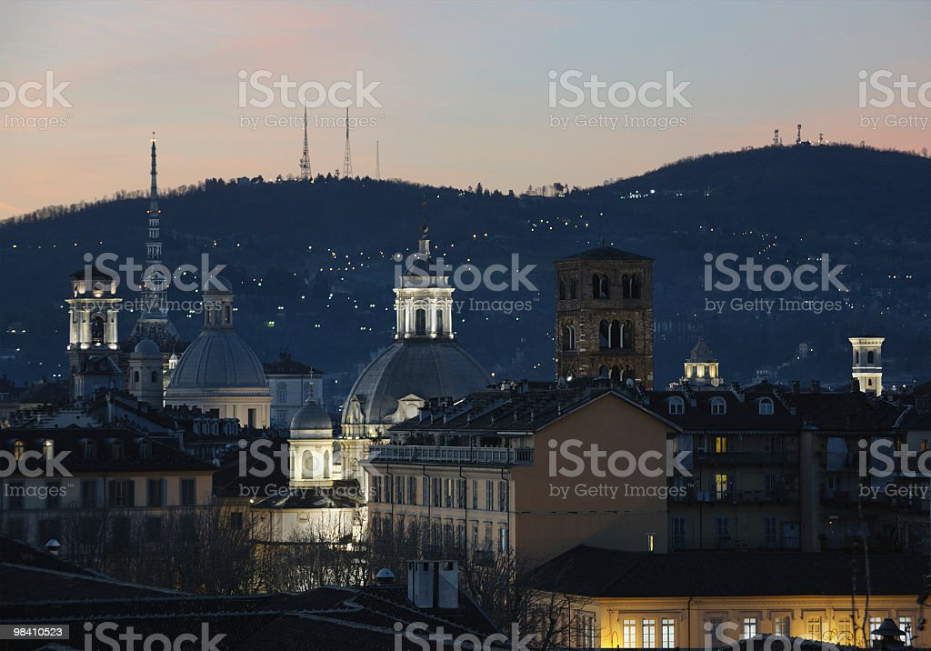 Center of Turin by night, with hills on the background royalty-free stock photo