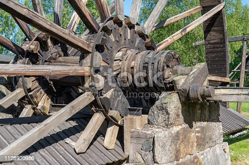 Close up detailed view of the nave or center of a large water wheel in Sweden