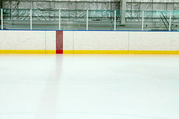 Center red line at a hockey rink and metal bleachers