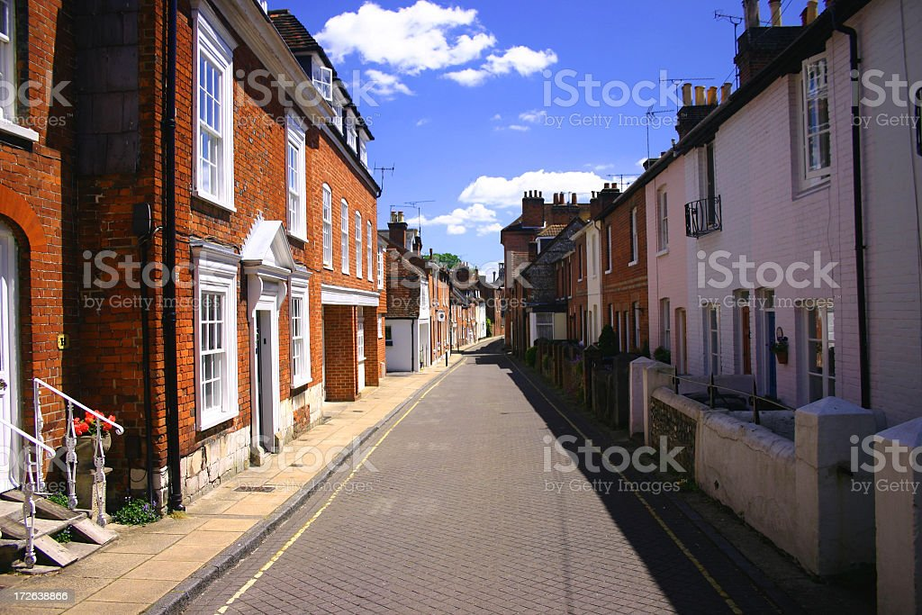 Center view of an old English street on a partly cloudy day stock photo