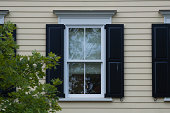outdoor daylight view of black shutters