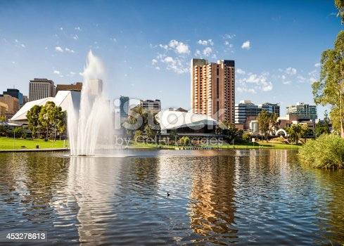 A view across the River Torrens in Elder Park, towards Adelaide's business, hotel and civic buildings.