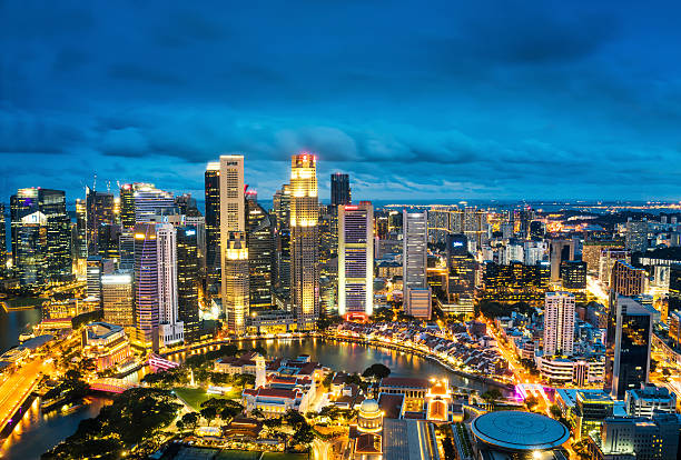 central business district in singapore at dusk - singapore nature stock photos and pictures