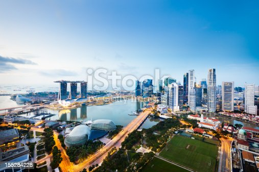 The Central Business District in Singapore City at twilight.