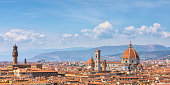 View of central Florence, Italy. On the left is the the tower of Palazzo Vecchio (town hall), and on the right Florence Cathedral.