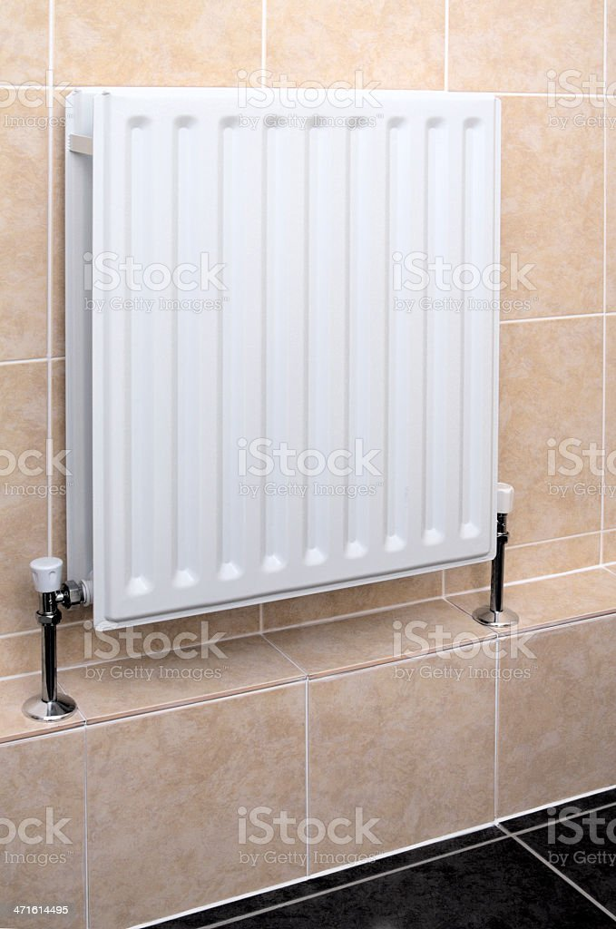 Central Heating Radiator In Modern Tiled Bathroom royalty-free stock photo