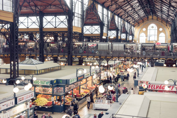 Central Market Hall, Budapest, Hungary Budapest, Hungary - October 2, 2018: General view from the first floor of the busy Grand Market Hall, or Central Market Hall as the official name, with more than 180 stalls selling everything from sausages, cheeses, spices and pastries. This market is the largest of the five markets in Budapest. Both locals and tourists gather in the market to shop and just take in a quick lunch by one of the many Hungarian food vendors. market hall stock pictures, royalty-free photos & images