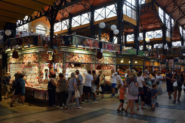 Central Market Hall in Budapest - Hungry. Budapest, Hungary - June 22, 2017: Central Market Hall in the Hungarian capital Budapest with visitors and customers shopping - Hungary. market hall stock pictures, royalty-free photos & images