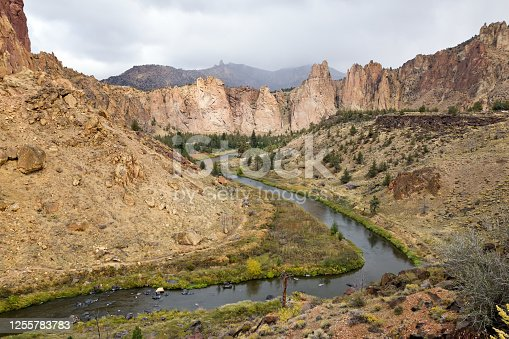 In central Oregon high desert, overcast clouds move in over the Cooked River in Smith Rock State Park.