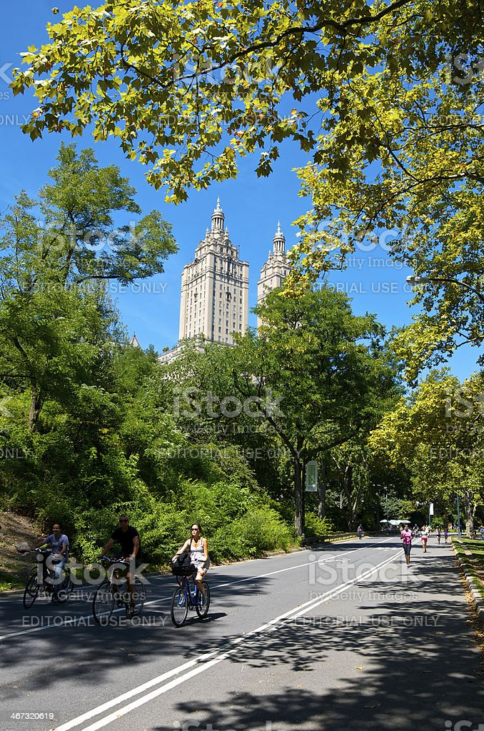 Central Park bicyclists, runners, West Side skyline, New York City royalty-free stock photo