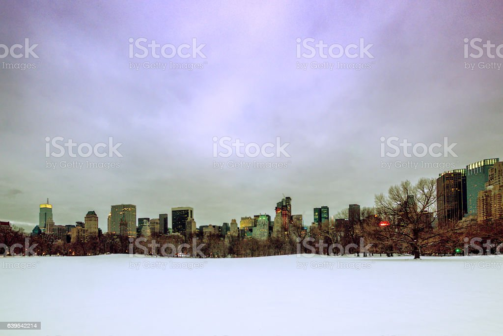 Central Park covered in snow - NYC sckyscrapers in background stock photo