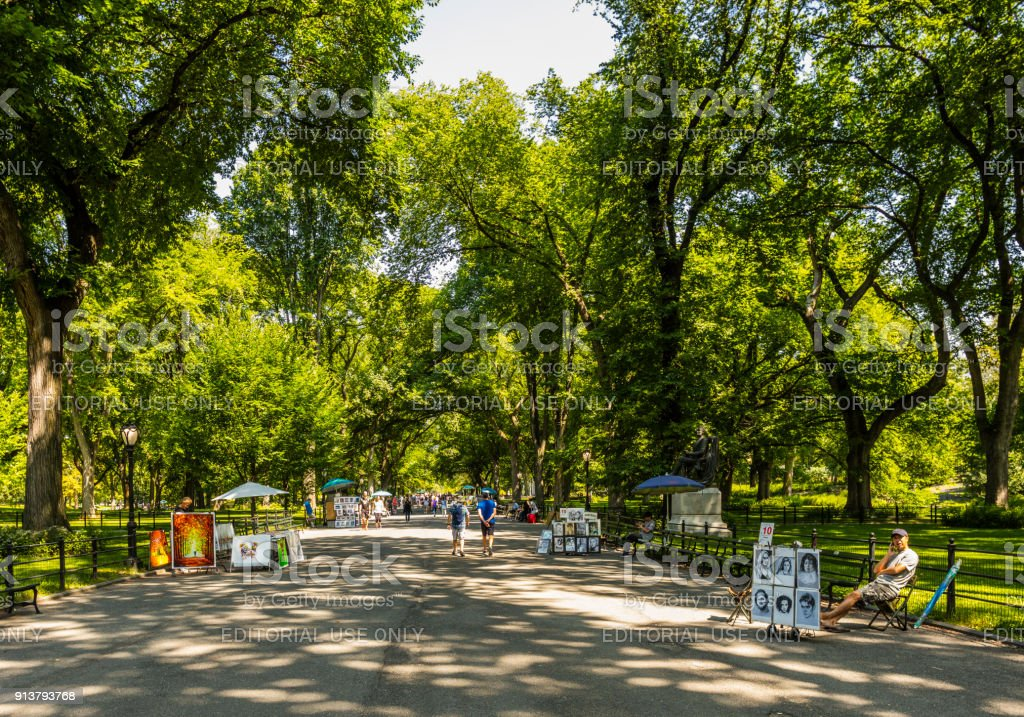 Central Park, in summer, with people walking and sidewalk vendors stock photo