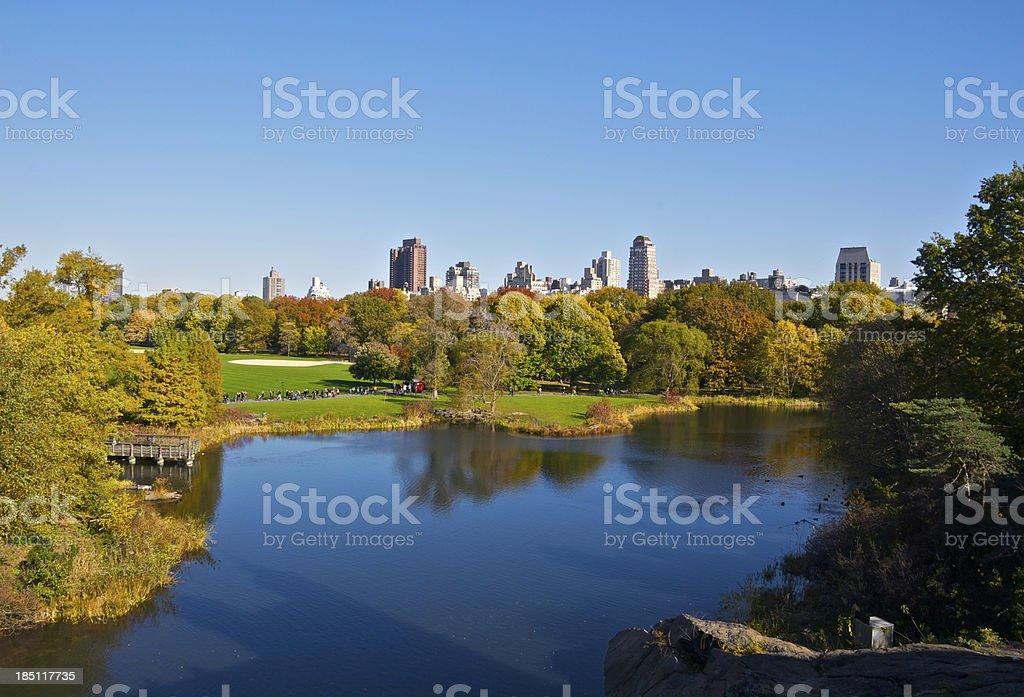 Central Park lake & East Side cityscape skyline, Manhattan, NYC stock photo