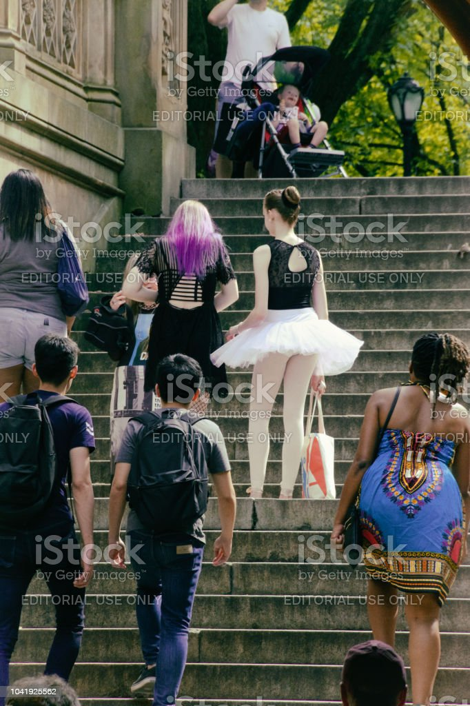 A diverse group of people climbing the steps of the historic Bethesda...
