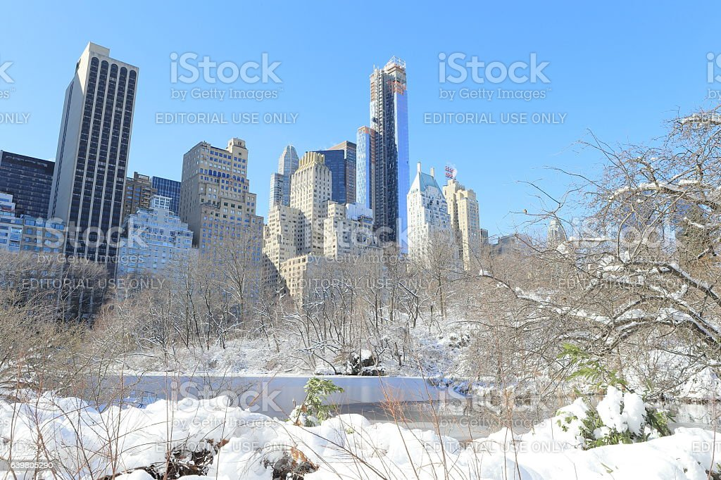 Central Park with Heavy Snow and Manhattan Buildings stock photo
